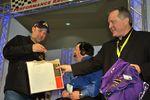 Doug Rice holding Matt Kenseth's Crown Royal apparel